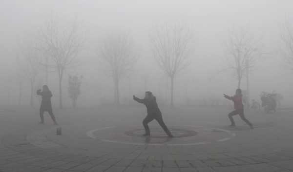 People practise Taiji on a foggy day at a park in Jiaozuo, central China's Henan province, January 28, 2013. China issued a blue-coded alert on Sunday as foggy weather forecast for the coming two days will cut visibility and worsen air pollution in some central and eastern Chinese cities, Xinhua News Agency reported. REUTERS/China Daily (CHINA – Tags: ENVIRONMENT) CHINA OUT. NO COMMERCIAL OR EDITORIAL SALES IN CHINA – RTR3D2UJ